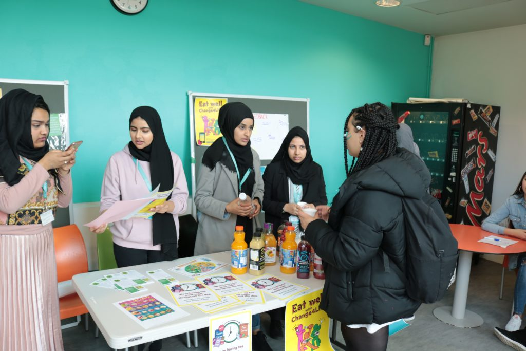 photo of students sampling smoothies around a table